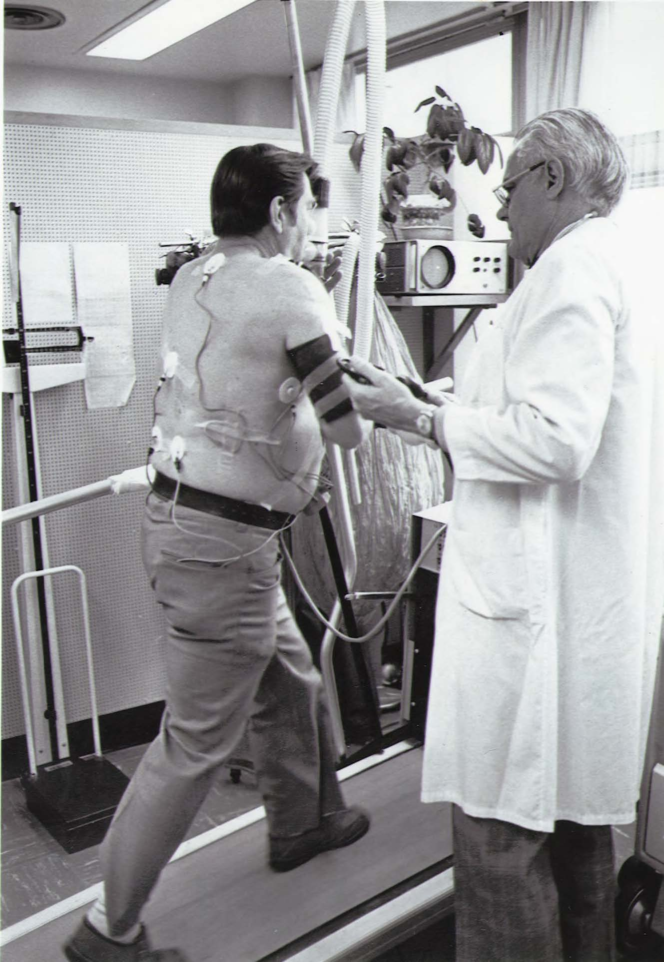 Dr. Robert Bruce conducts a treadmill test on a patient.